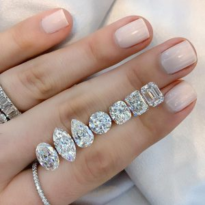 various diamond shapes ladies hand with jewelry
