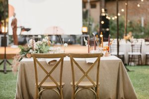outdoor wedding reception bride groom table set flowers candles wine glasses