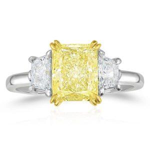yellow diamond radiant cut diamond side stones three stone engagement ring white gold platinum